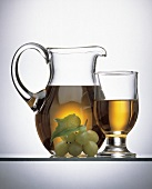 White Grape Juice in a Pitcher and in a Glass; Grapes