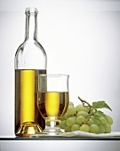 White Grape Juice in a Bottle and in a Glass; Grapes