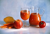 Vegetable Juice From Carrots and Tomato in a Pitcher and Glass