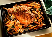 Leg of lamb with carrots & potatoes in a baking pan