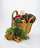 A Basket Full of Vegetables; Vegetables in front of Basket