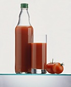 Tomato Juice in a Bottle and in a Glass; Tomatoes