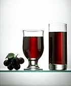 Two glasses of red grape juice