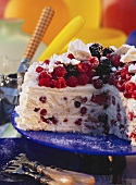 Ice cream gateau with meringue & berries, a piece cut