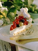 A piece of cheesecake with fruit and berries