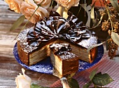 Tree cake gateau with chocolate fans, a piece cut