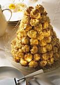 Croquembouche -profiteroles with amaretto cream filling