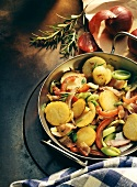 Potato dish with peppers, red onions, leeks, rosemary