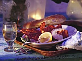 Cooked lobster with lemon & a glass of wine