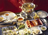 Assorted Platters of Food to Dip in a Fondue Pot