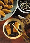 Chopsticks Holding Shandong Chicken Over Sauce