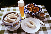 White Sausage in a Tureen and on a Plate; Beer and Pretzels