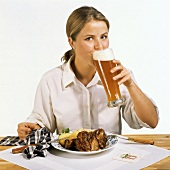 Woman Drinking Wheat Beer with Dinner