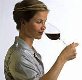 A Woman Sniffing a Glass of Wine