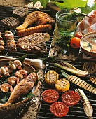 Fish, meat, vegetables, kebabs on the grill