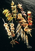 Assorted kebabs with fish, seafood and vegetables