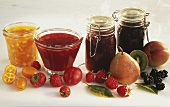 Four Assorted Jams in Glass Jars