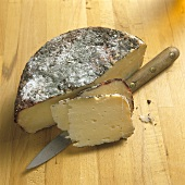 Pecorino Cheese Partially Sliced; Knife
