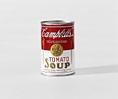 Campbell's tomato soup tin against a light backdrop