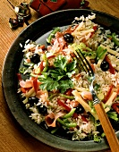 Rice salad with ham, salami, olives, cheese & pepper