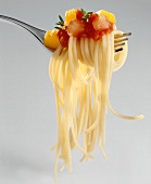 Spaghetti Twirled on Fork with Vegetable Sauce