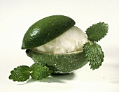 Lime Sorbet Served in a Lime; Mint Leaves