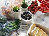 Cakes, vegetables, fruit, herbs, shrimps in freezer containers