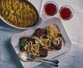 Steak with onions and potato gratin (Italy)