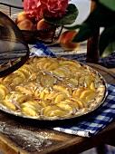 Peach tart in round baking dish