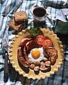 Irish breakfast (with sausage, fried egg, bacon, toast etc)