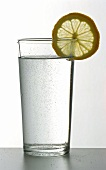 Glass of fizzy mineral water with lemon slice