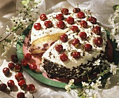 A cherry gateau, a piece cut