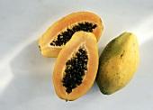Papaya Cut in Half with a Whole Papaya