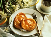 Apricot puff pastry on cake plate