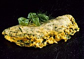 Herb omelette with sweetcorn and onion filling