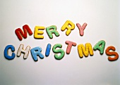 Colourful pastry letters spelling Merry Christmas