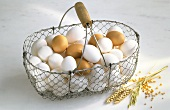 White and Brown Eggs in Wire Basket