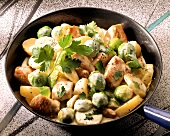 Pan-cooked potato and Brussels sprouts with diced pork