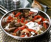 Pan-cooked pepper & lamb, sheep's cheese, onions & yogurt sauce
