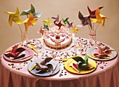 Child's birthday table with amusingly decorated cake