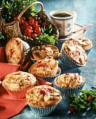 A few cranberry muffins with flaked almonds in cases