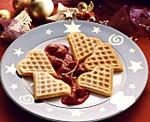 Wafer hearts with icing sugar on cherry compote on a plate