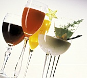 Assorted Vegetable and Fruit Juices in Stem Glasses