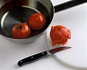 Placing tomatoes briefly in boiling water before peeling