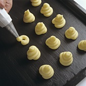 Piping potato on to baking sheet (duchess potatoes)