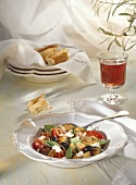 A Serving of Sauteed Vegetables; Bread; Red Wine
