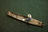 Person Fishing in Boat on Chinese River