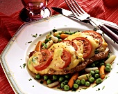 Pork escalope with tomatoes & toasted cheese on vegetables