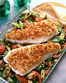 Cod fillets in breadcrumbs on vegetables