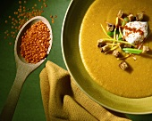 Red lentil soup decorated with crème fraiche and bread cubes